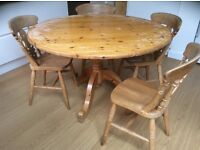 Solid wooden circular table and four comfortable solid wooden chairs