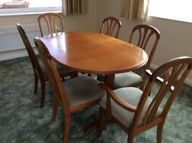 Solid teak extending dining table & chairs with matching display cabinet