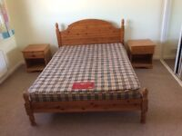 Pine double bed, mattress and two bedside tables
