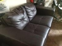Two seater dark brown sofa. Buyer to collect from Garden Lane area.