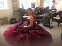 Designer wedding dress. Worn once.Size 10/12. Deep red taffeta silk.Magnificent detail. With veil.