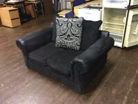 Black fabric two seater sofa
