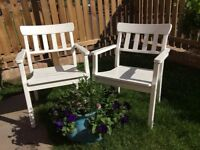 Two white wood garden chairs