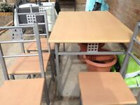 No longer available. Table and 4 chairs