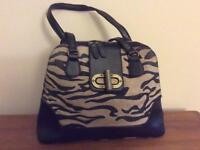 Faux suede tiger print Handbag with brown trip and antiqued brass buckle fastener