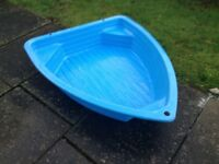 Large boat shaped paddling pool or sand pit