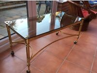 Smoked glass top, brass coffee table