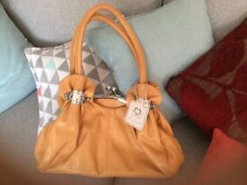 Beige move & moda handbag