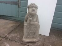 Concrete garden man with sign ornament