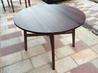 Dark wooden circular dining table + two chairs