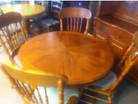 VERY GOOD CONDITION!!! Round solid wooden extendable dining room table and four patterned chairs