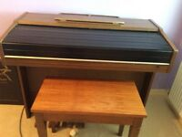 Yamaha ELectric Organ with stool and music book