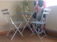 Metal, white, folding garden / patio table and chairs. Excellent condition.