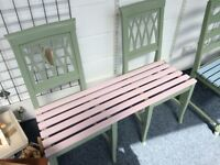 Cute pink and green garden bench for two
