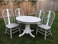 Round dining table and 4 chairs
