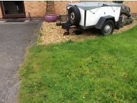 Handy little car/ box trailer in sound condition with PVC cover.