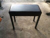 Piano stool.