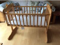 Beautiful wooden swinging crib