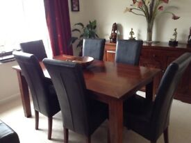 Extending dining room table chairs and side board
