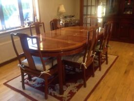 Beautiful rosewood Chinese style dining room table with key design and eight dining room chairs