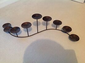 Candle holder in bronze metal