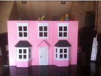 Wooden dolls house with bits of funiture