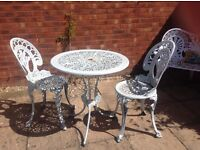 Shabby chic table and two chairs.