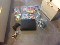 PlayStation 3 with games with box good condition