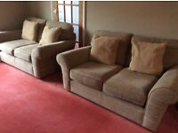 Two 2 seater sofas and 1 armchair