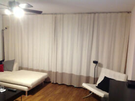2 pairs of light cream curtains