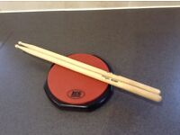XCG 6 inch drum pad and sticks
