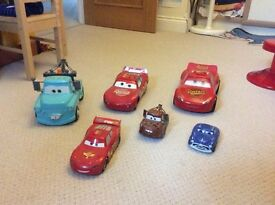 Lightening McQueen & friends push along cars