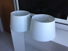 Two large white pendant shades