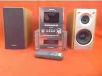 Panasonic music system. 5 CD changer, stereo radio, cassette player, twin speakers, remote control.