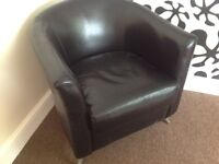 Black leather look tub armchair
