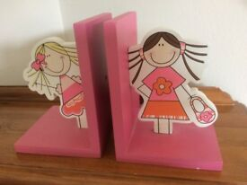 Two delightfully painted wooden bookends for children