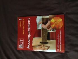 RGT accompaniment book for grade 1 acoustic guitar, new, unused.