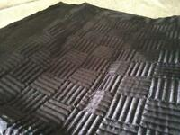 Quilted black satin throw