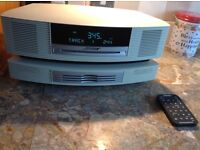 Bose wave music system, cream, with cd changer, very little use, stored for a while
