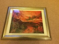 Beautiful landscape picture in a gold frame