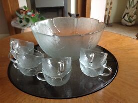 Glass punch bowl and glass cups