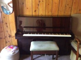 modern upright piano excellent condition. With piano stool purchaser would have to collect