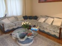 Large corner unit with 2and3seater sofas plus two matching armchairs and circular glass coffee table