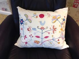 """Featherfilled cushion 20""""x 18"""" white background with colourful embroidered motifs"""