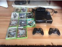 Xbox 360 with 10 games and 2 wireless controllers
