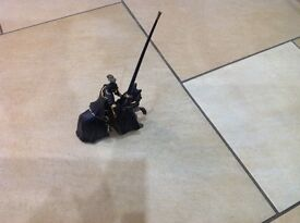 Great quality black and gold schleich knight on horseback