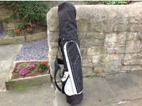 A set of new golf clubs including drivers and putter, plus golf bag .