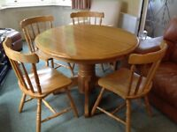 Round rubber wood table and 4 chairs