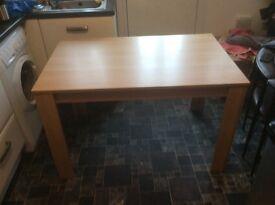 Table oak effect. Brand new flat packed. Height: 74cm width: 77cm length:117cm.