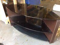 Glass tv stand, smoked glass .